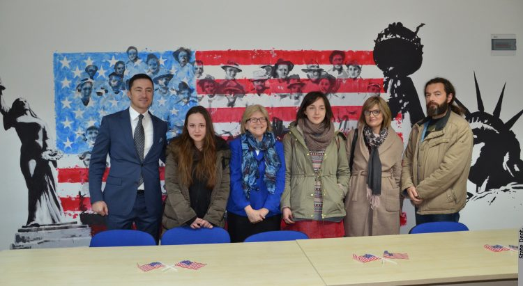 Ambassador Uyehara, Mayor of Cetinje Bogdanovic, three female students and their male teacher posing for a family photo