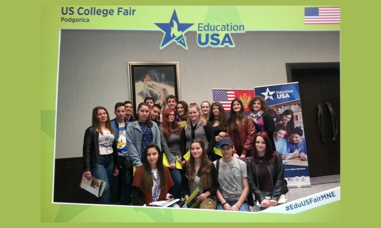 Students posing within a frame reading EducationUSA