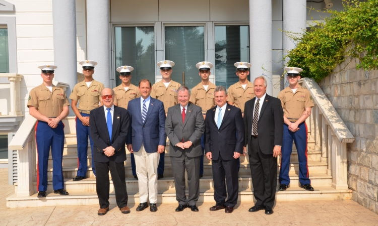 Five Congressmen with Marines on stairs