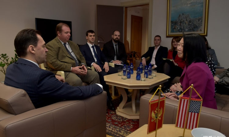 DCM Kuo and Minister Pazin sitting with a group of people